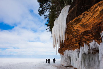 Large Cliff and Icicles at Frozen Lake Superior Shore