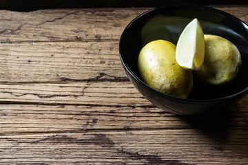 lemons in  black bowl
