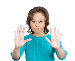 Senior business woman asking to stop, hand gesture