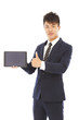 businessman holding a tablet and thumb up