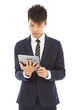 young businessman holding a tablet and watching screen