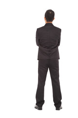 full length of businessman standing and cross arms