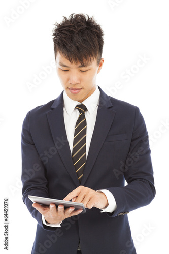 young businessman holding a tablet and touching screen