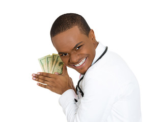 Greedy doctor. Portrait health care professional holding dollars
