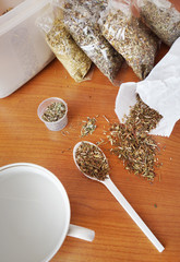 Phytotherapy. Dry medicinal herbs on a table