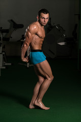 Bodybuilder Performing Side Triceps Poses
