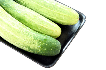 cucumber in black tray container isolated.
