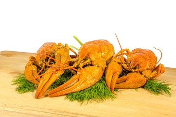 River crayfish on a wooden board