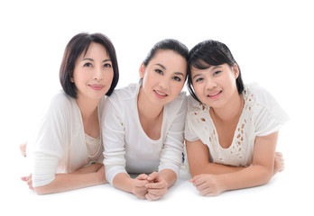 Cheerful family having fun together lying on