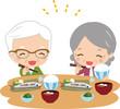 食事をする笑顔の老夫婦