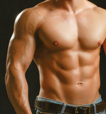 Healthy muscular young man. Isolated on black background.