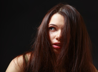 Depressed woman , isolated on black background.