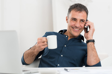 Happy Mature Man Talking On Cellphone