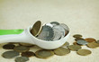 Spoon full of money