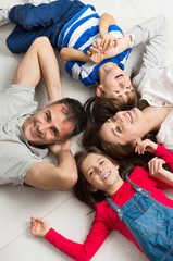 Smiling Family Lying On Floor