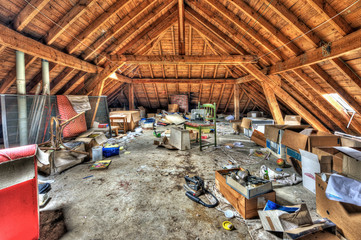 Messy attic roof space at abandoned house