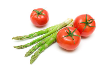 asparagus and tomatoes isolated on white background