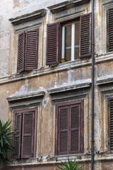 Old windows of a house in Trastevere, Rome, Italy