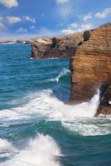 Waves break about rocks,  Portugal