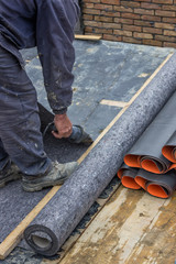 Worker cutting insulation material for basement wall 4