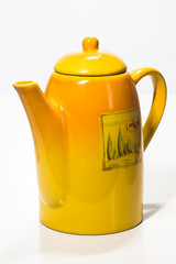 Yellow teapot on a white background