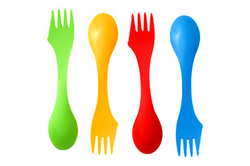Four plastic varicolored camping cutlery tools spoons and forks