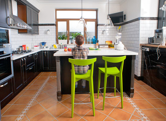 Boy sitting in front of table in the kitchen