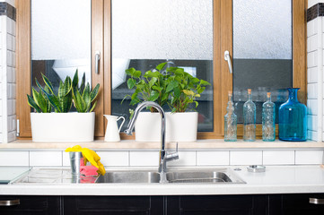 Water tap and sink in a vintage kitchen interior