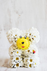 Bear from flowers with strawberry basket