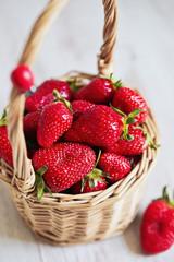 Basket of fresh strawberry on white background with ladybug