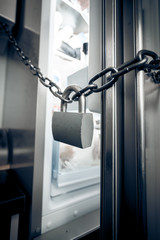 photo of metal lock hanging on refrigerator door