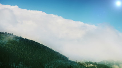 Tatra Mountains: Clouds over the tops with blue sky