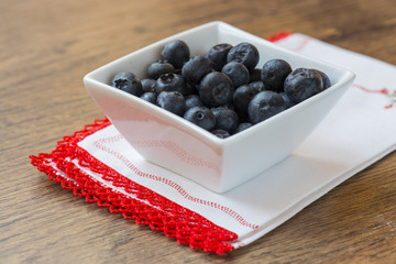 blueberries on white cup