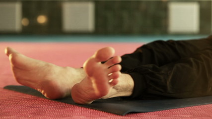 Yoga man warming up foot exercise