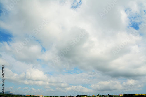 village under clouds