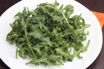 Rocket salad on white plate