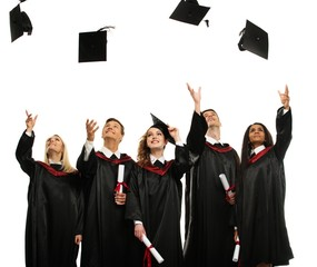 Happy multi ethnic group of graduated students throwing hats