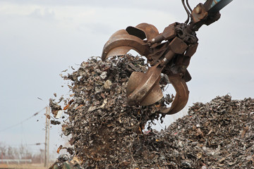 Grabber crane working with metal waste