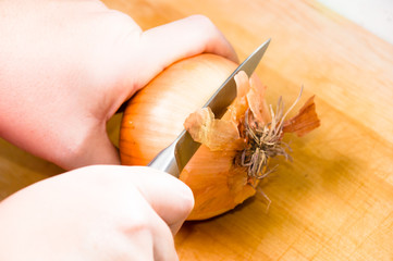 woman peeling onion