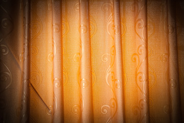 Brightly lit orange curtains