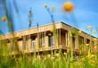 Leinwanddruck Bild - Holzhaus modern ökologisch Gebäude Holzfassade in Natur
