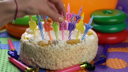 Woman put candle on the birthday cake