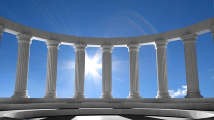 Ancient marble pillars in elliptical arrangement with blue sky