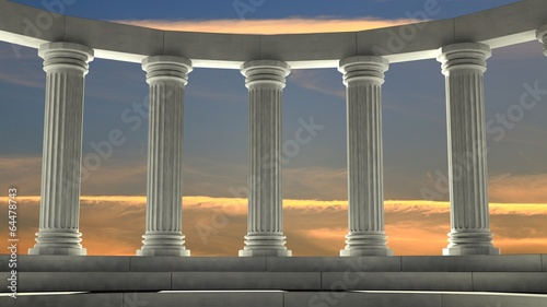 Ancient marble pillars in elliptical arrangement with orange sky - 64478743