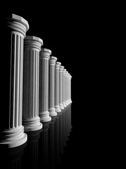 Ancient white marble pillars in a row isolated on black