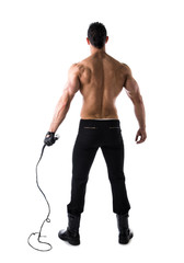 Full body shot of muscular man with whip seen from the back