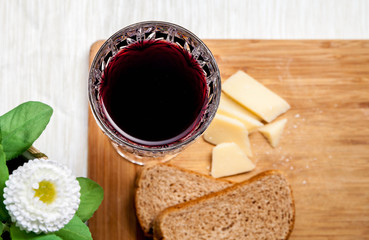Simple lunch with bread, parmesan and wine