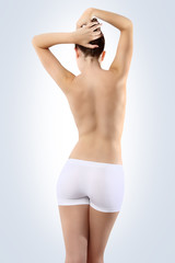 Body of woman ass and back on white background
