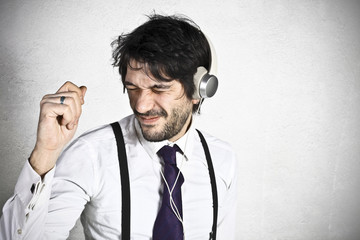 Young businessman dance to music