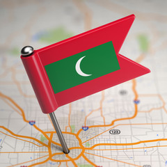 Maldives Small Flag on a Map Background.